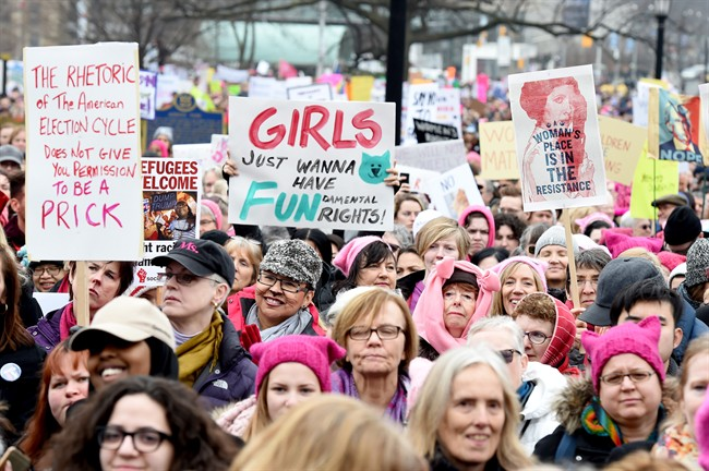 Protesters march, in support of the Women's March on Washington, in Toronto on Saturday, January 21, 2017.