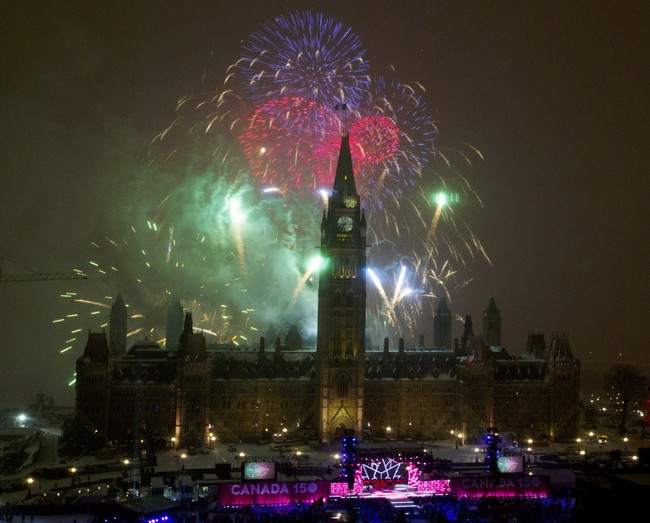 Fireworks explode over Parliament Hill to celebrate New Year's Eve and Canada's 150th anniversary of Confederation on Parliament Hill in Ottawa, Saturday, December 31, 2016.