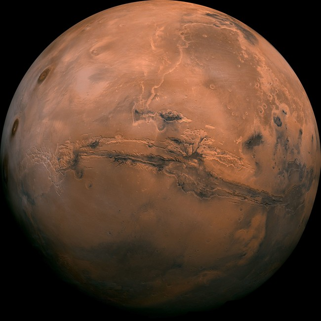 This image provided by NASA shows the planet Mars.