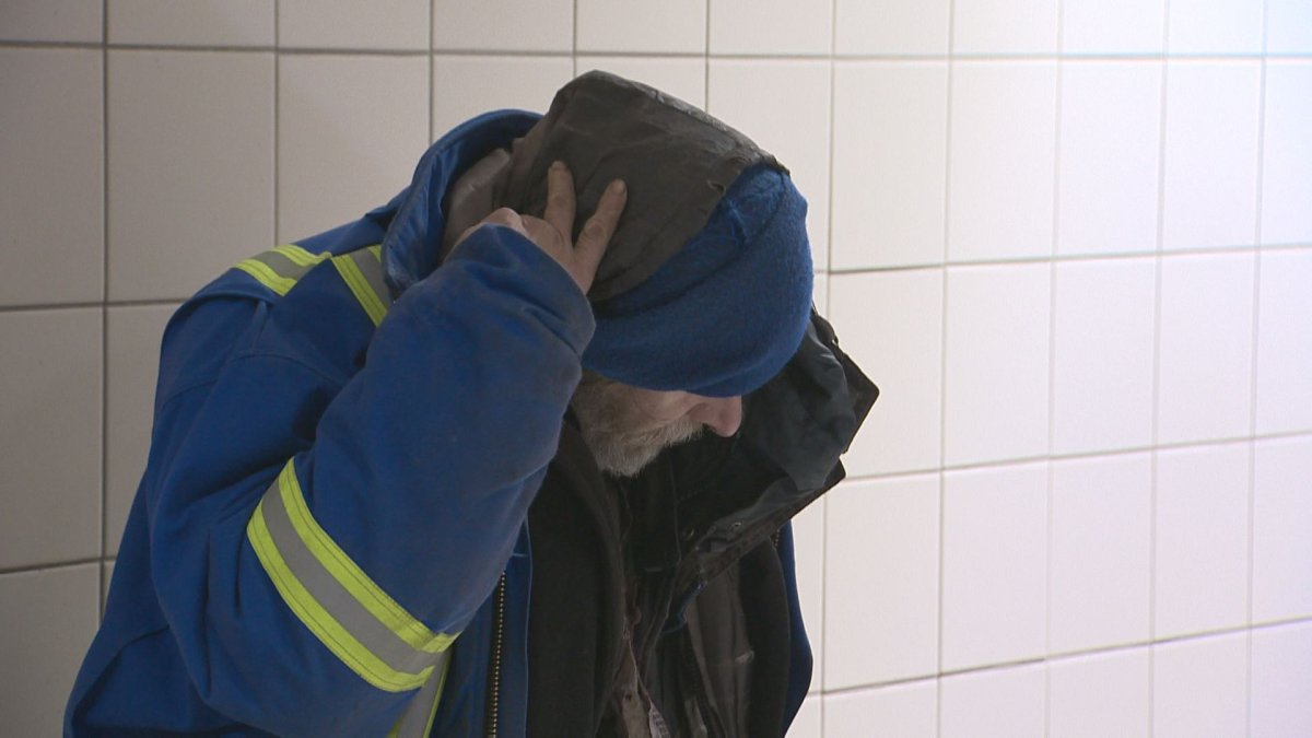 File shot of an Edmontonian seeking shelter in Churchill LRT Station, Jan. 12, 2017.