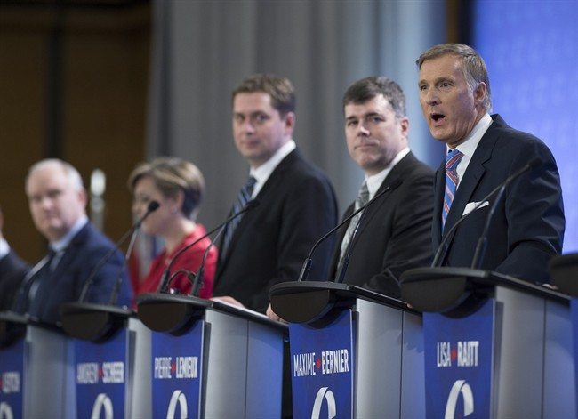 Leadership candidate Maxime Bernier, right, speaks during the Conservative Party French language leadership debate, Tuesday, January 17, 2017 in Quebec City. Looking on are Erin O'Toole, from the left, Kellie Leitch, Andrew Scheer, and Pierre Lemieux.
