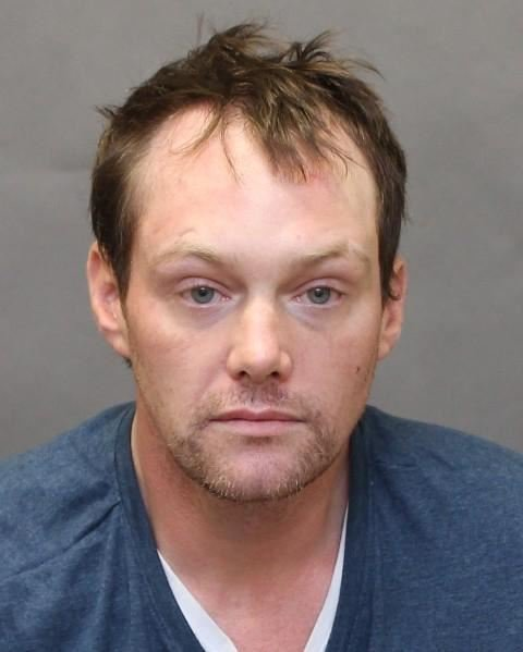 Police are warning the public not to approach Justin Yates, 39, if spotted.