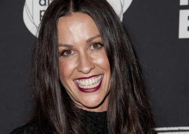 This June 20, 2014 file photo Alanis Morissette arrives at the 4th Annual Production Of The 24 Hour Plays After-Party in Santa Monica, Calif.