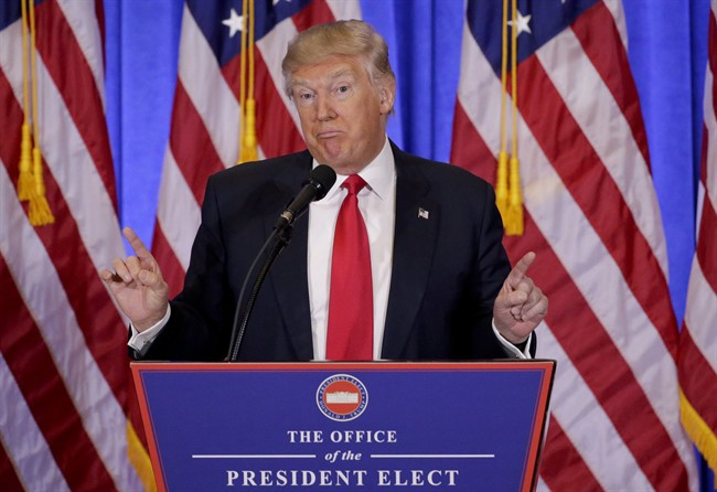 In this file photo dated Wednesday, Jan. 11, 2017, President-elect Donald Trump speaks during his first news conference as President-elect, in New York.