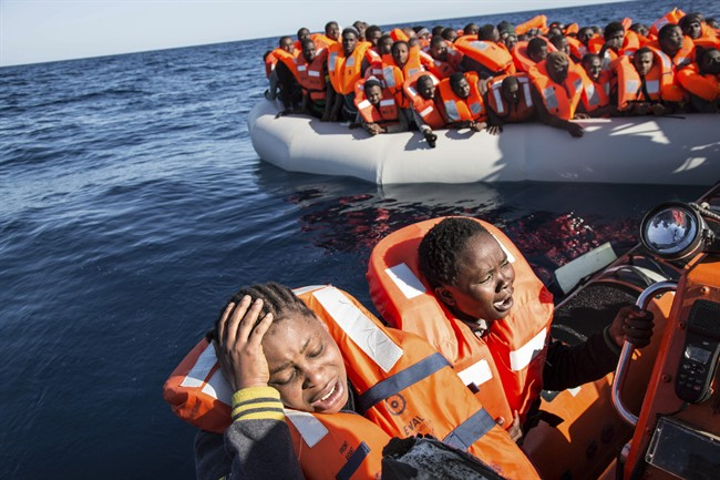 A migrant reacts to being rescued by the MV Aquarius, after 191 people and two corpses were recovered Friday Jan. 13, 2017, from international waters in the Mediterranean Sea about 22 miles north of Sabrata, Libya.