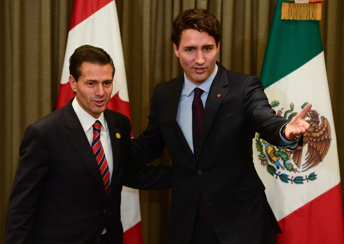 Prime Minister Justin Trudeau meets with Mexican President Enrique Pena Nieto during the APEC Summit in Lima, Peru on Saturday, Nov. 19, 2016.