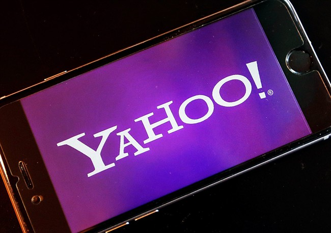 FILE - In this Dec. 15, 2016, file photo, the logo of Yahoo appears on a smartphone in Frankfurt, Germany. (AP Photo/Michael Probst, File).