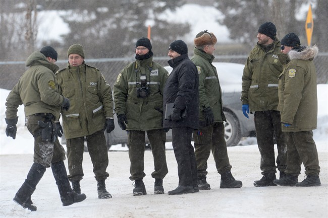 Police attend the scene near a Quebec City mosque on Monday, January 30, 2017. A mass shooting left six people dead and another 19 wounded at the mosque.