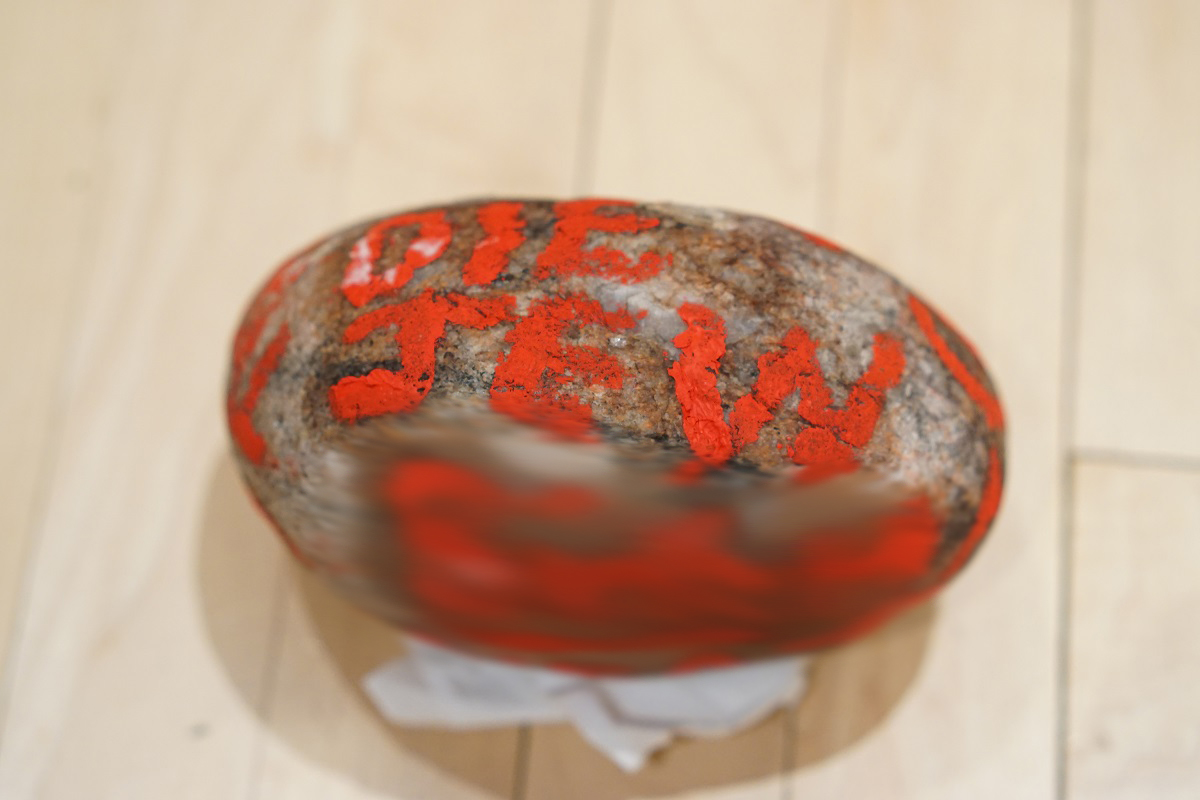Photo of a rock with racist writing on it was left on a doorstep of a home in Wolseley.