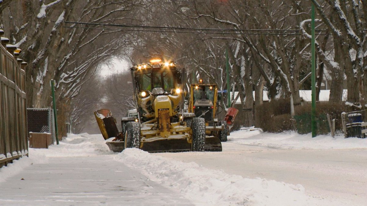 A snow plow clears a snowy Calgary road on Monday, Jan. 2, 2017.