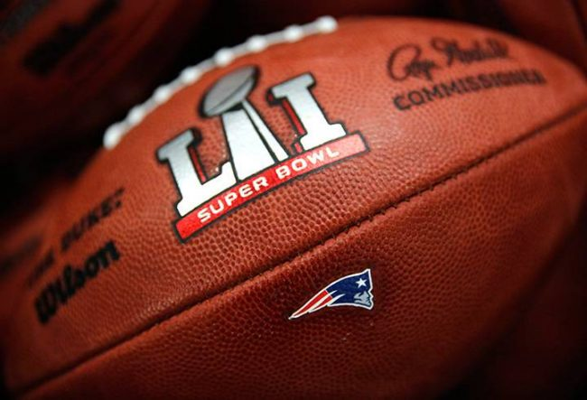 The New England Patriots' NFL Super Bowl LI game ball is finished with the team's logo affixed to it at the Wilson Sporting Goods factory Monday, Jan. 23, 2017, in Ada, Ohio.