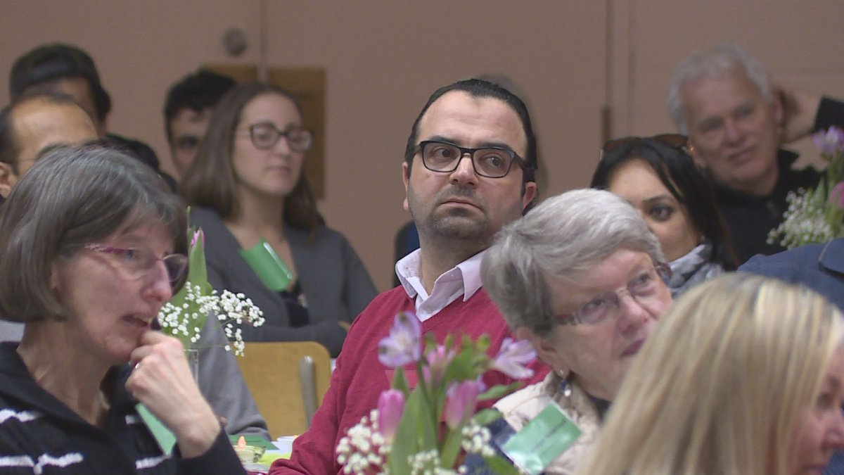 Syrian newcomer Mohammed Bakhash listens to speeches at the MCAF Community Connections Appreciation Night  .