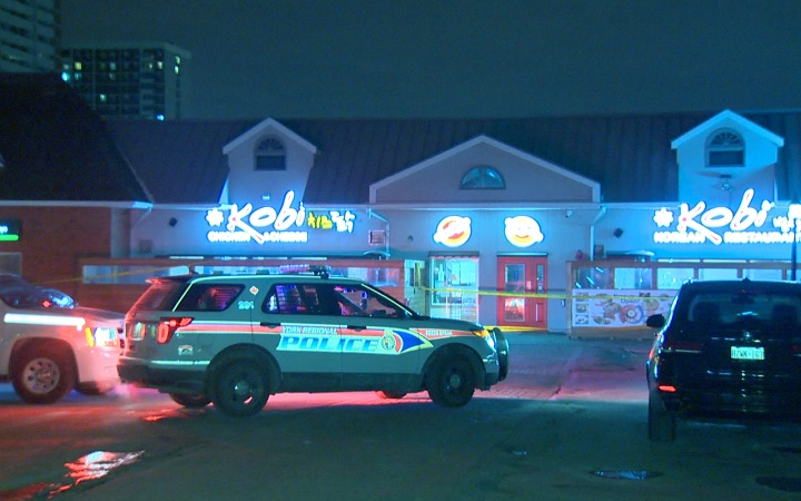 Police investigate a shooting at a strip mall on Steeles Avenue East in Thornhill, Ont., on Jan. 31, 2017.