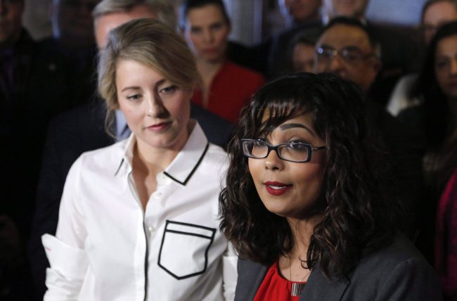 Liberal MP Iqra Khalid makes an announcement about an anti-Islamophobia motion on Parliament Hill while Minister of Canadian Heritage Melanie Joly looks on in Ottawa on Wednesday, Feb. 15, 2017.