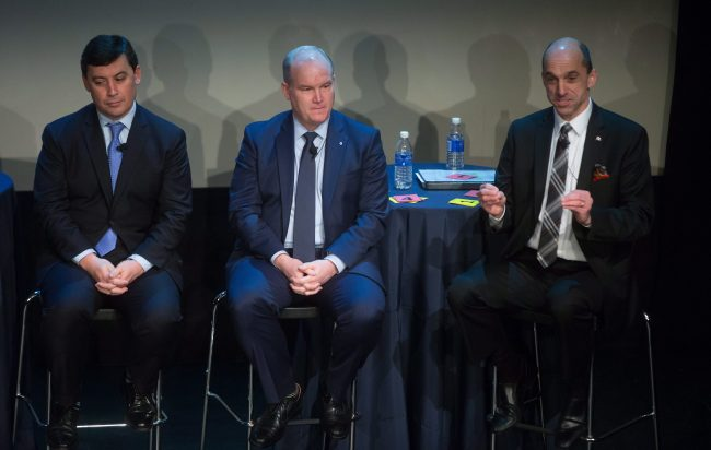 Candidates Michael Chong, left, and Erin O'Toole, centre, listen as Steven Blaney speaks during a federal Conservative Party leadership debate in Vancouver, B.C., Feb. 19, 2017.