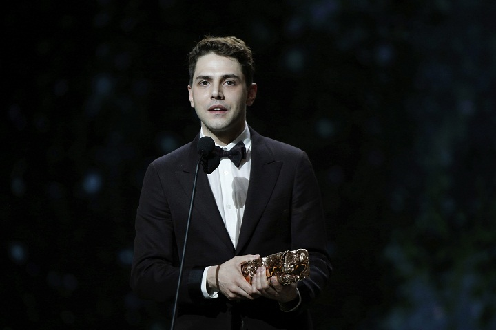 """French Canadian actor and film director Xavier Dolan speaks after winning the Best Editing award for """"Juste la fin du monde"""" (It's Only the End of the World) during the ceremony of the 42nd Cesar Film Awards, at the Salle Pleyel, in Paris, France, Friday, Feb. 24, 2017. This annual ceremony is presented by the French Academy of Cinema Arts and Techniques. (AP Photo/Thibault Camus)"""