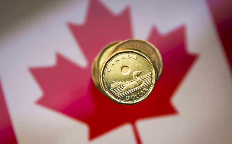 """A Canadian dollar coin, commonly known as the """"Loonie"""", is pictured in this illustration picture taken in Toronto January 23, 2015."""