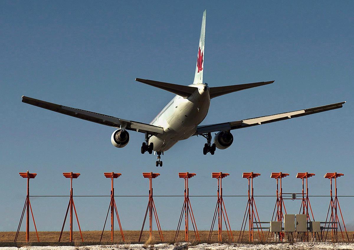 An Air Canada passenger jet lands at Halifax Stanfield International Airport in Halifax on Monday, Jan. 21, 2013.