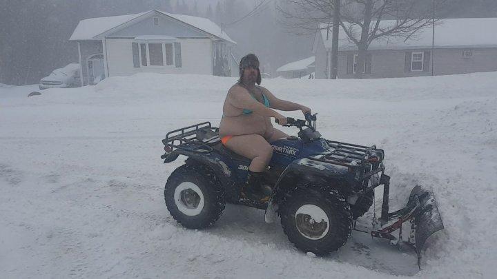Bikini-clad New Brunswick man plows snow on ATV, creates