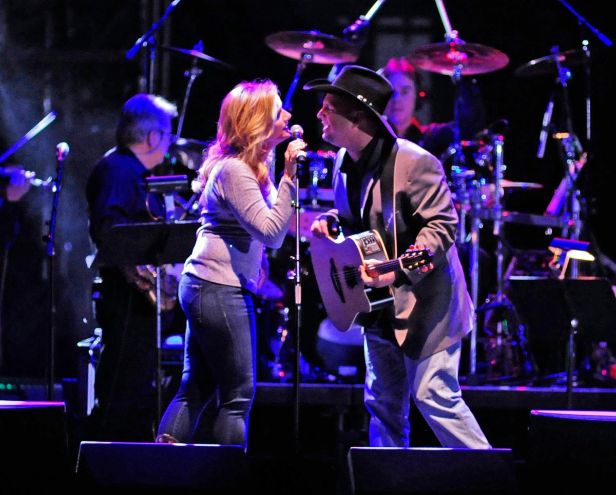 Trisha Yearwood and Garth Brooks perform at the tribute concert for the late George Jones, Friday, Nov. 22, 2013, in Nashville, Tenn.