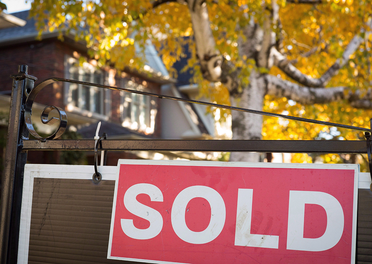 A real estate sold sign hangs in front of a west-end Toronto property Friday, Nov. 4, 2016.