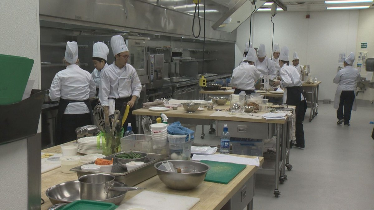 High school students compete in a culinary challenge.