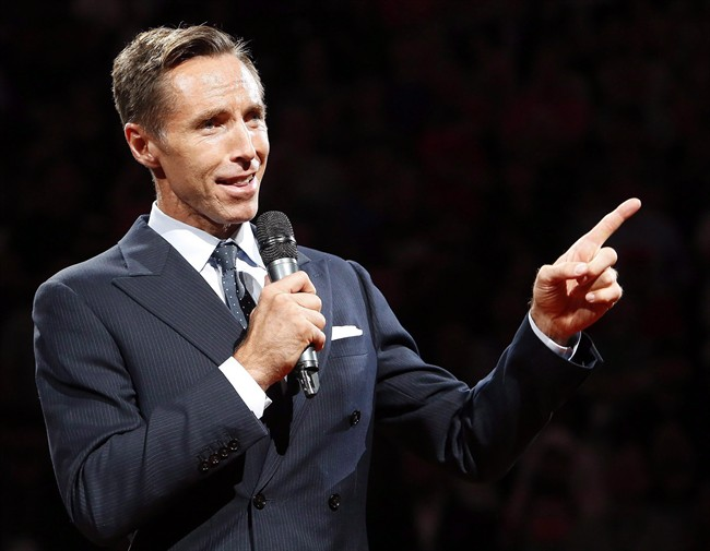 Two-time NBA most valuable player Steve Nash is introduced into the Suns Ring of Fire at halftime of an NBA basketball game between the Phoenix Suns and the Portland Trail Blazers, Friday, Oct. 30, 2015, in Phoenix. A chain of fitness clubs accused of using Steve Nash's name without permission is going on the offensive and suing the former basketball superstar's company for allegedly damaging its reputation. T.