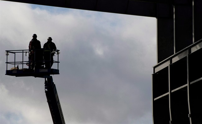 Workers are pictured at the Vancouver Shipyard in an October 7, 2013, file photo.