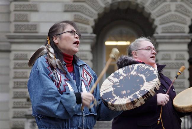 Marcia Brown Martel (left) is seen outside court in Toronto on Thursday, Dec. 1, 2016.