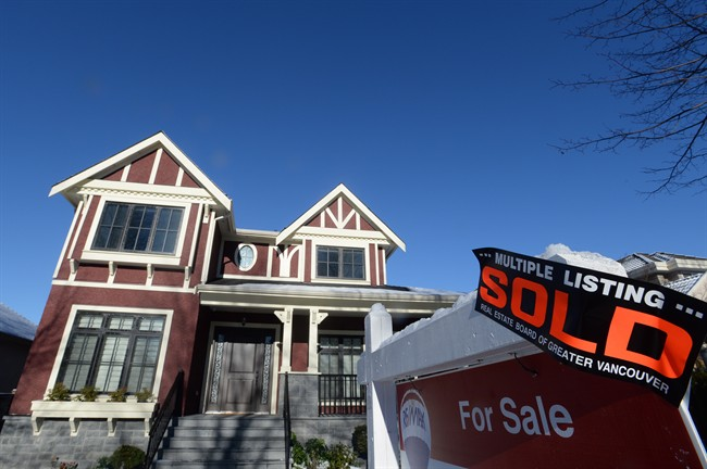 A real estate sold sign is shown outside a house in Vancouver, Tuesday, Jan.3, 2017. Home sales in Metro Vancouver last month dropped by almost 40 per cent compared with January 2016 with the sale of detached houses falling hardest.