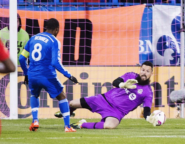 Montreal Impact midfielder Patrice Bernier (8) scores the first goal against Toronto FC goalkeeper Chris Konopka (1) during first half Major League Soccer sudden death playoff game in Montreal on October 29, 2015. Former Toronto FC goalkeeper Chris Konopka has joined FC Edmonton of the North American Soccer League.