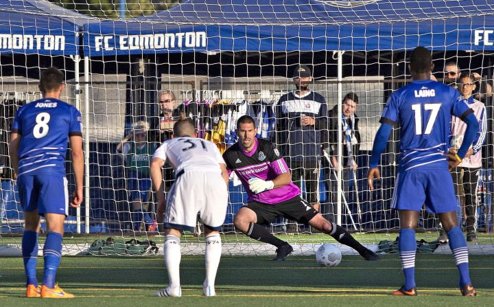 Vancouver Whitecaps' Russell Teibert (31) watches the ball go past Edmonton FC goalkeeper Matt VanOekel (1) as Ritchie Jones (8) and Lance Laing (17) look on during first half action of the Amway Canadian Championship semi-final in Edmonton, Alta., on Wednesday May 20, 2015.
