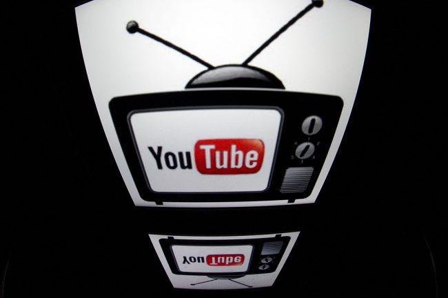 """The """"YouTube"""" logo is seen on a tablet screen in Paris, Dec. 4, 2012."""