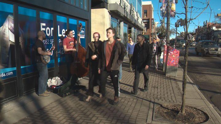 People out enjoying the unseasonably warm February weather in Edmonton.