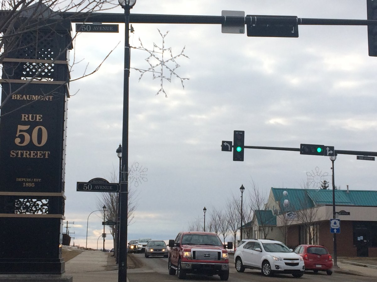 Cars go by in downtown Beaumont, Alta.