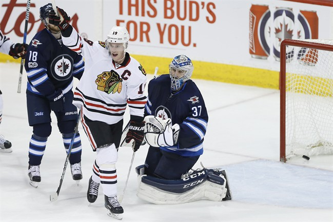 Chicago Blackhawks centre Jonathan Toews celebrates defenceman Duncan Keith's goal against the Winnipeg Jets in the third period of Friday's game.