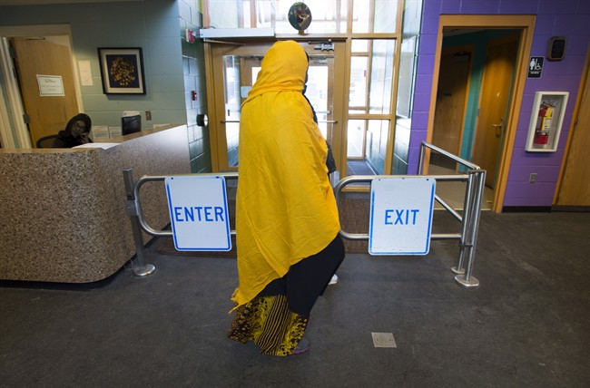 A Somali woman walks through the halls of the Pillsbury United Community Centre in Minneapolis, Minn., on Wednesday, Feb. 15, 2017. The centre is a main meeting place for the large local Somali community and is where an immigration centre has been set up to try and help people interested in leaving the United States.
