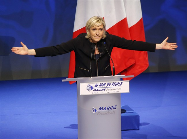 FILE - In this Sunday, Feb. 5, 2017 file photo, Far-right leader presidential candidate Marine Le Pen gestures as she speaks during a conference in Lyon, France. If Marine Le Pen has her way, the French will soon pay for their baguettes with francs, not euros. The presidential candidate from the anti-EU, anti-immigration National Front party is all about national sovereignty and independence. She wants France to take control of its money, subject to a referendum that would lead France out of the European Union and its shared currency. (AP Photo/Michel Euler, file).