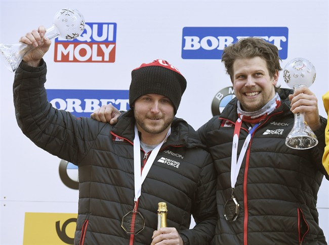 Canada's Justin Kripps, left, and Jesse Lumsden, celebrate their second place after the men's two-man bob race at the Bobsleigh and Skeleton World Championships at Lake Koenigssee, Germany, Sunday Feb. 19. 2017.
