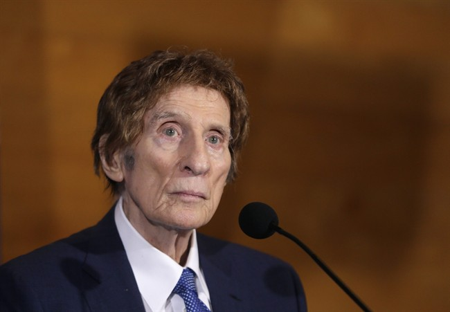 Detroit Tigers owner Mike Ilitch listens during a news conference in Detroit in this Nov. 14, 2014 file photo.