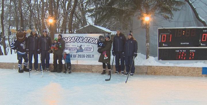 Manitoba Moose players skate on backyard rink - image