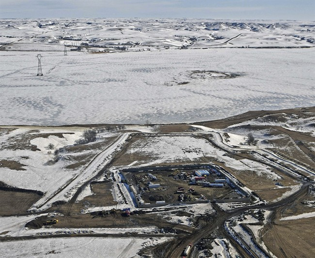This aerial photo shows a site where the final phase of the Dakota Access Pipeline will take place with boring equipment routing the pipeline underground and across Lake Oahe to connect with the existing pipeline in Emmons County, Monday, Feb. 13, 2017, in Cannon Ball, N.D. It is the last big section of the $3.8 billion pipeline, which would carry oil from North Dakota to Illinois. A federal judge on Monday refused to stop construction on the last stretch of the pipeline, which is progressing much faster than expected.
