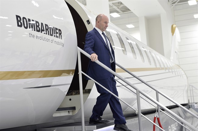 Bombardier CEO Alain Bellemare steps off of a model of a Global 7000 jet before making a press conference in Montreal on Tuesday, February 7, 2017.