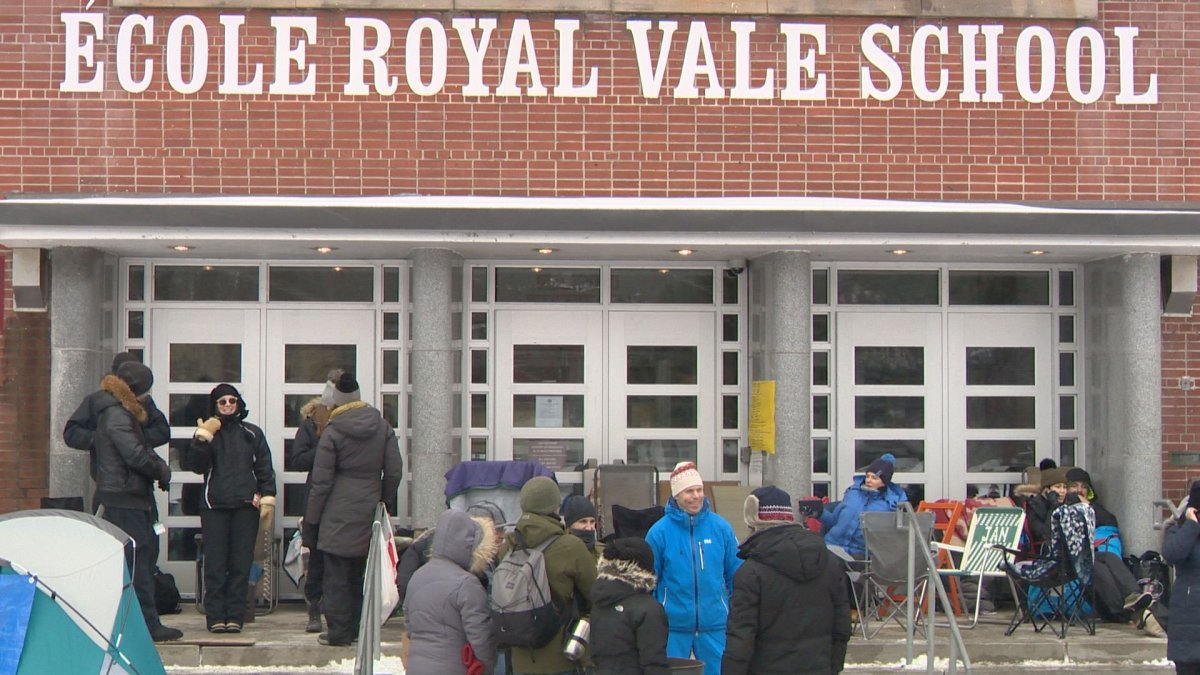 Despite cold weather, parents have already begun lining up for registration at Royal Vale School, Sunday, February 5, 2017.
