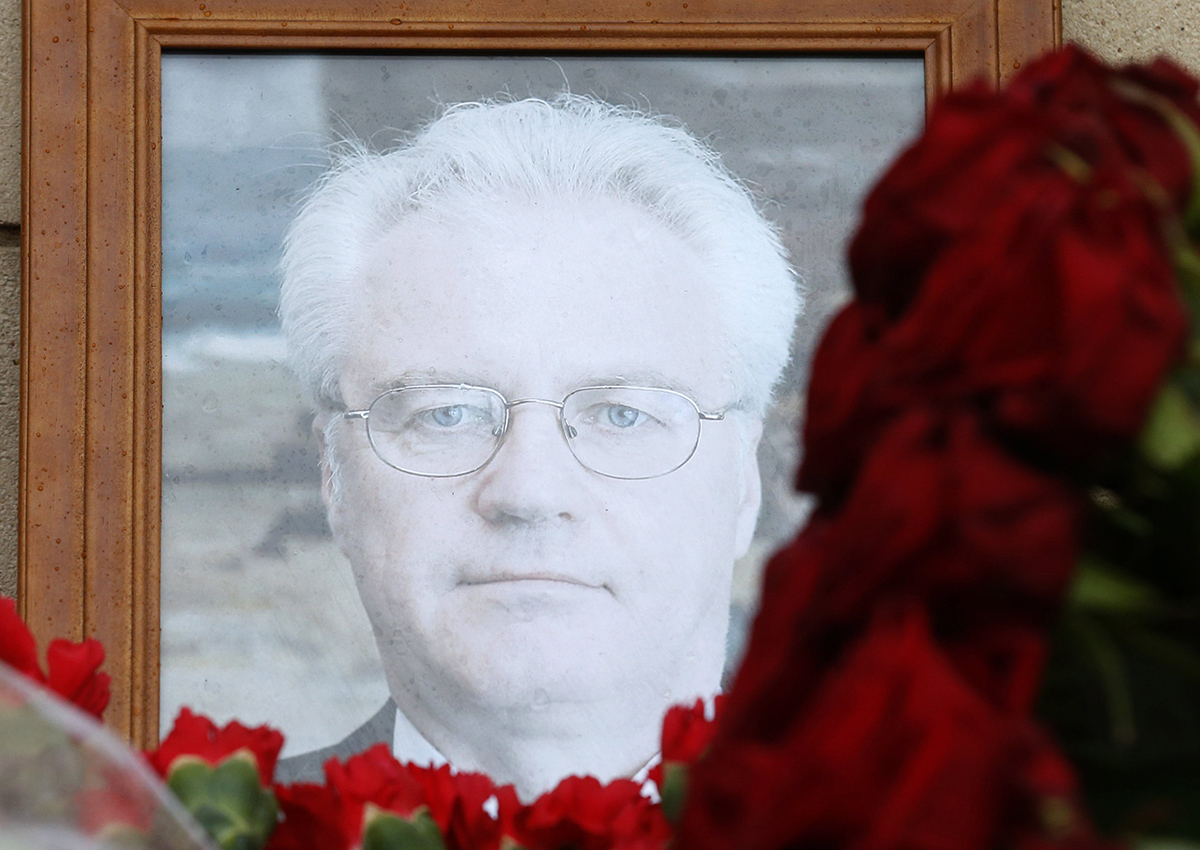 Flowers are placed near a portrait of late Russian Permanent Representative to the United Nations Vitaly Churkin at the Foreign Ministry headquarters in Moscow, Russia.