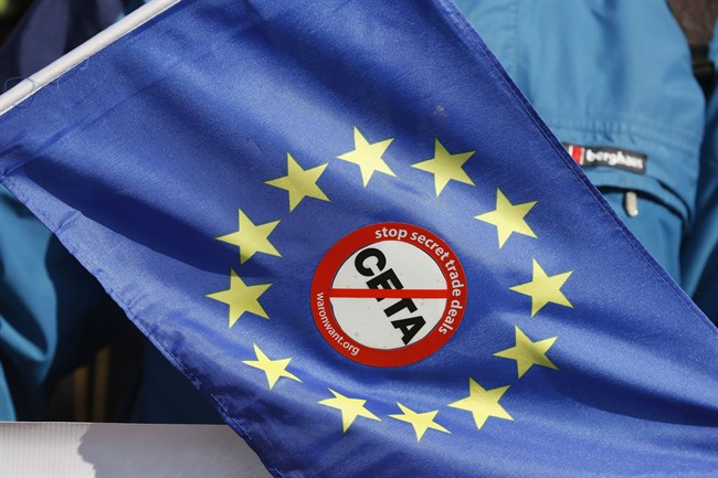 An anti-CETA sticker is pictured on an European flag during a demonstration against the so-called CETA trade deal outside the European Parliament in Strasbourg, eastern France, Wednesday, Feb.15, 2017.