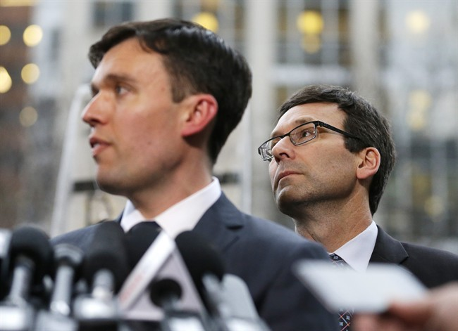 Washington state Solicitor General Noah Purcell, left, and Attorney General Bob Ferguson, right, listen to questions from reporters, following a hearing in federal court Friday, Feb. 3, 2017, in Seattle. A U.S. judge on Friday temporarily blocked President Donald Trump's ban on people from seven predominantly Muslim countries from entering the United States after Washington state and Minnesota urged a nationwide hold on the executive order that has launched legal battles across the country.