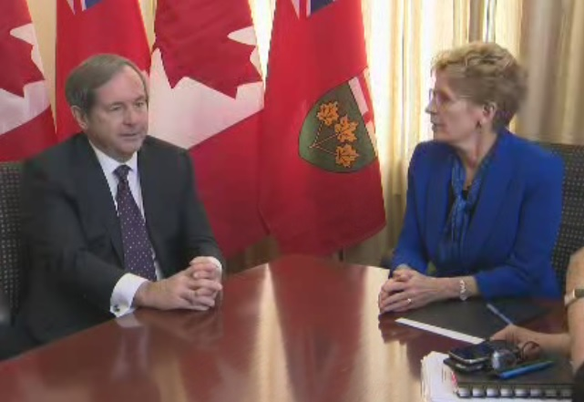 Ontario Premier Kathleen Wynne and Canada's ambassador to the United States David MacNaughton meet at Queen's Park in Toronto on Feb. 15, 2017.