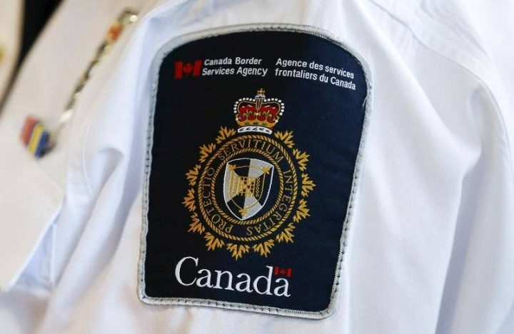 A Canada Border Services Agency (CBSA) logo is seen on a worker during a tour of the Infield Terminal at Toronto Pearson International Airport in Mississauga, December 8, 2015.