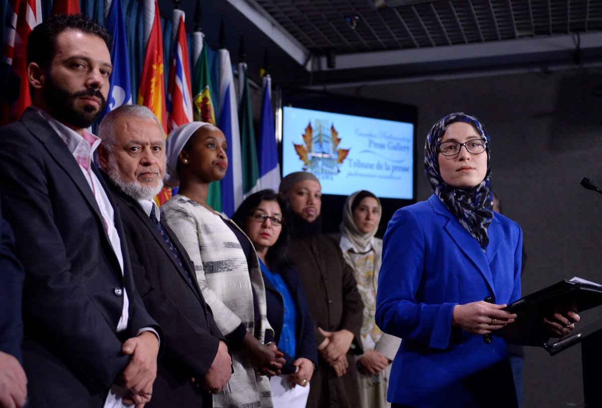 National Council of Canadian Muslims communications director Amira Elghawaby, right, on Parliament Hill on Wednesday, Feb. 8, 2017 in Ottawa.